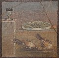 Wall painting of cup with olives, tray with fish and two partridges from the Villa of Diomedes, Pompeii, Naples National Archaeological Museum (14658996419).jpg