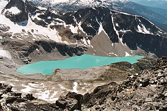 Garibaldi Provincial Park - Wedgemount Lake with Whistler Mountain visible in the top right corner.