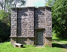 A small rectangular stone building