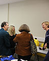 Wikimedia board member, council staff and Welsh government staff chatting at MonmouthpediA launch day.JPG