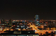 Zagreb at night, with a wide street and several tall buildings