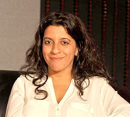 A photograph of Zoya Akhtar smiling, looking towards the camera.