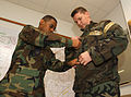 (L to R) SrA Bernard Harper, a Readiness Journeyman for the 31st Civil Engineer Squadron assists SrA Christopher C. Croley, an Aircraft Armorment Journeyman for the 31st Aircraft Maintenance Squadron on the 031007-F-RX586-006.jpg