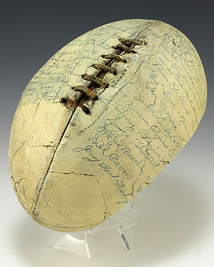 Ball (gridiron football) - A white football signed by the members of the 1935 Collegiate All-Star Team, including Gerald Ford.