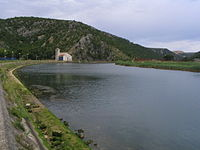 Croatian river with small mountain in background