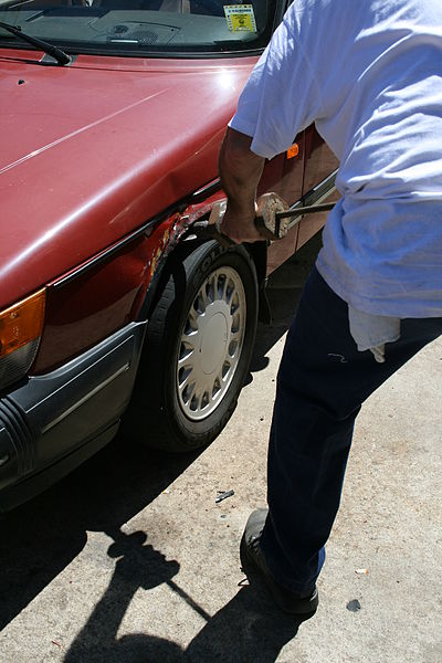 File:2008-08-11 Mechanic straightening fender.jpg