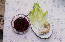 "Maror, one disallowed type and two acceptable kinds (L to R): ""chrein"" (Yiddish)- grated horseradish with cooked beets and sugar, not acceptable maror due to its sweetness; romaine lettuce; and whole horseradish root, often served grated."