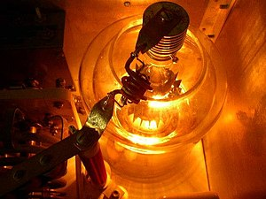 Hot cathode - Glow of a directly heated cathode in an Eimac 4-1000A 1 kW power tetrode tube in a radio transmitter.  Directly heated cathodes operate at higher temperatures and produce a brighter glow.  The cathode is behind the other tube elements and not directly visible.