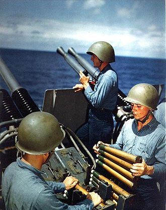 Alaska-class cruiser - Crew of a Bofors 40 mm gun on Alaska mount loading clips into the loaders of the left pair of guns on 6 March 1945 during the Battle of Iwo Jima.