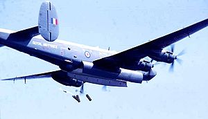 No. 204 Squadron RAF - A Shackleton, possibly of 204 sqn, performing a mail drop over Beira street, September 1971, photographed from aboard HMS Minerva