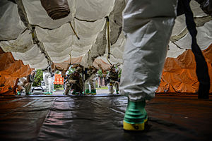 628th Air Base Wing - 628th Medical Group erects a decontamination tent during an exercise
