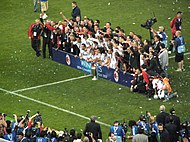 AC Milan team celebrate.jpg