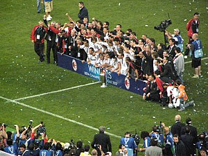 2007 UEFA Champions League Final - Milan players celebrate with the trophy.