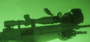 Night vision device - A standard telescopic sight augmented with a night vision device in front. Note that in addition to the image intensifier the NVD gathers much more light via its much larger aperture