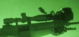 Night-vision device - A standard telescopic sight augmented with a night-vision device in front. Note that in addition to the image intensifier, the NVD gathers much more light by its much larger aperture