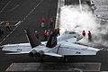 A U.S. Navy F-A-18F Super Hornet is directed to a steam catapult aboard the aircraft carrier USS Dwight D. Eisenhower (CVN 69) as the ship conducts flight operations in the Red Sea on March 18, 2013 130318-N-GC639-185.jpg
