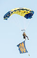 A U.S. Sailor with the Leap Frogs parachutes onto the field at Notre Dame Stadium in South Bend, Ind., Sept. 6, 2014, before a football game 140906-D-KC128-146.jpg
