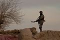A member of the Afghan National Civil Order Police stands guard on a rooftop in the Maiwand district, Kandahar province, Afghanistan, Feb. 24, 2012 120224-A-QD683-235.jpg