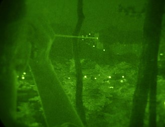 Laser designator - USAF handheld laser beam as seen under night vision, 2007