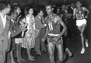 1960 Summer Olympics - Abebe Bikila of Ethiopia wins the marathon barefooted