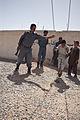 Afghan police build swing set for boys school 120517-M-DM345-024.jpg