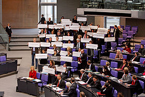 2009 Kunduz airstrike - Members of Germany's Left Party hold up the names of the dead during a debate