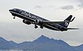 Alaska Airlines 737 in unique colors lifting off from ANC (IMG 1396a) (6335510492).jpg