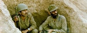 Iraqi invasion of Iran (1980) - Ali Khamenei (right), the future Supreme Leader of Iran, in a trench during the Iran-Iraq war.