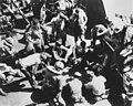 American servicemen relaxing on deck on a convoy ship bound for Australia (4925535312).jpg