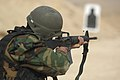 An Afghan National Army Air Corps (ANAAC) trainee fires his M-16 rifle (4274269202).jpg