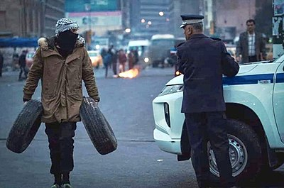 An Iraqi protestor during the January protests in Baghdad.jpg