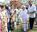 An old lady being escorted to polling booth to cast her vote, at a polling booth, during the 2nd phase of Assam Assembly Election, at Maidamgaon, Bakarapara, Basistha, in Kamrup district on April 11, 2016.jpg