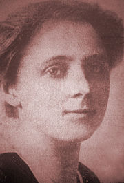 Close-up of a young woman with relatively short hair; she is gazing directly at the camera.