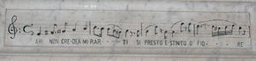 """Musical notation, inscribed on Bellini's tomb, from Amina's last aria in La sonnambula: """"Ah! non-credea mirarti / Sì presto estinto, o fiore"""", translated as: """"I did not believe you would fade so soon, oh flower"""" (Source: Wikimedia)"""