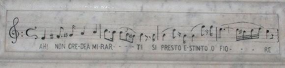 "Musical notation, inscribed on Bellini's tomb, from Amina's last aria in La sonnambula: Ah! non credea mirarti / Si presto estinto, o fiore; translated as: ""I did not believe you would fade so soon, oh flower"" Annoncredamirarti.JPG"