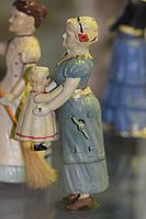 Antique wind-up toy mother tossing child (25231419254).jpg