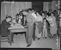 Arcadia, California. Attendants register arrivals at Santa Anita assembly center and assign them fa . . . - NARA - 537045.tif