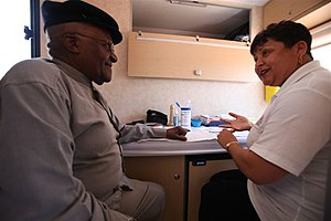 HIV/AIDS in Africa - Archbishop Desmond Tutu gets an HIV test on the Desmond Tutu HIV Foundation's Tutu Tester, a mobile test unit.