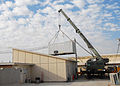 Armored crane moves shipping containers while expanding the ROLE 3 Hospital on Kandahar Airport -b.jpg