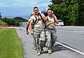 Army Staff Sgt. Matthew Adams, left, a military policeman assigned to the 10th Regional Support Group, and Army Sgt. Miles McGreehan, a military policeman assigned to the 10th RSG, leads the 10th RSG's team 130514-A-TY664-352.jpg