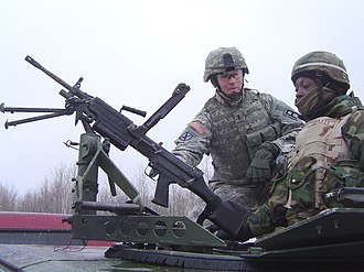 174th Infantry Brigade (United States) - A soldier of the 174th Infantry Brigade trains a reservist on convoy duty at Fort Drum, New York.