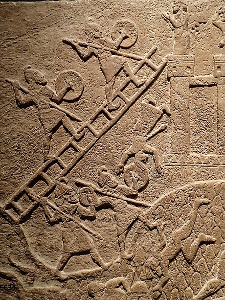 Assyrians using siege ladders in a relief of attack on an enemy town during the reign of Tiglath-Pileser III 720-738 BCE from his palace at Kalhu (Nimrud) Assyrian relief of attack on an enemy town during the reign of Tiglath-Pileser III 720-738 BCE from his palace at Kalhu (Nimrud).jpg