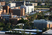 photo of the campus of Arizona State University, taken from a high angle from the top of Tempe Butte, looking down on the campus nestled among the city buildings