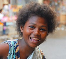 Ati girl going around the town of Kalibo on Panay island in central Philippines.
