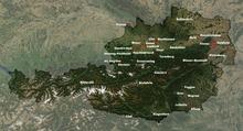Satelliittikartta nykyaikaisesta Itävallasta, jossa on osa punaisilla pisteillä merkittyjä alaleirejä.