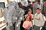 Automatic Soldiers give to Iraqis during holiday season DVIDS70181.jpg
