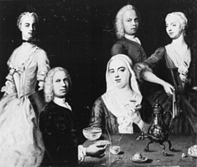 The artist sitting at the table with his family. Self-portrait