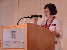 Barbara Simons at a lectern