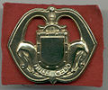 Baretembleem Korps Nationale Reserve gedragen tot 1982.jpg