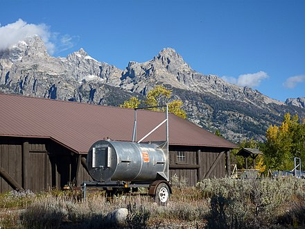 Drum or barrel trap, used to safely relocate bears, adjacent to a building in Grand Teton National Park in Wyoming, United States Bear trap GTNP1.jpg
